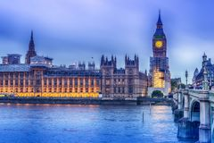 London, the United Kingdom: the Palace of Westminster with Big Ben, Elizabeth Tower, viewed from across the River Thames. At night Stock Image