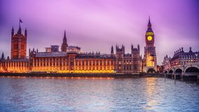 London, the United Kingdom: the Palace of Westminster with Big Ben, Elizabeth Tower, viewed from across the River Thames. At night Royalty Free Stock Photos