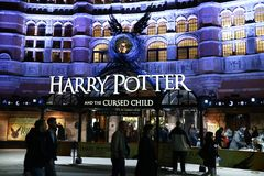 London, United Kingdom - 12/23/2017: People waiting outside to s. Ee an evening showing of Harry Potter and the Cursed Child in London, UK Royalty Free Stock Photography