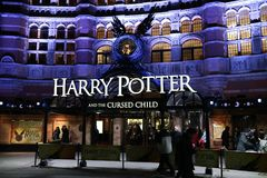 London, United Kingdom - 12/23/2017: People waiting outside to s. Ee an evening showing of Harry Potter and the Cursed Child in London, UK Royalty Free Stock Photo