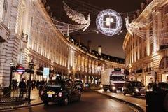 London, United Kingdom. Regent street by night, with Christmas light illuminations, black cab, cars, capital, London Royalty Free Stock Image