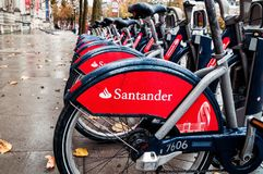 London, United Kingdom, Row of Santander bikes. These are bicycles available to hire by the public, sponsored by Santander Bank in London, UK Stock Images