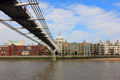 LONDON, UNITED KINGDOM, SEPTEMBER 27, 2014: Millennium bridge and st. pauli cathedral - view from thames Royalty Free Stock Photos