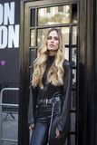 Skinny blonde in black leather trousers and denim jacket. LONDON, United Kingdom- SEPTEMBER 14 2018: People on the street during the London Fashion Week. Skinny royalty free stock image