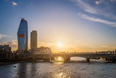 London, United Kingdom - Sunset at Blackfriars bridge and station with skyscraper. At background Stock Image