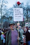 London, United Kingdon - Febuary 20th, 2017: Protesters gather in Parliment Square to protest the invitation to United States Pre. Sident Donald Trump on a state stock image
