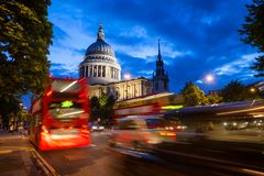 London urban scene with Double Decker bus moves along the St Pau Stock Image