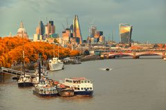 London, view over river on St. Paul`s cathedral and Blackfriars. London, view over river Thames on St. Paul`s cathedral and Blackfriars bridge with Sun reflected Stock Photo