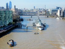London, View from Tower Bridge on River Thames with HMS Belfast, London Bridge. London, view from Tower Bridge on River Thames with HMS Belfast former warship of stock images