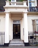 London, vintage house entrance with dark door and columns. London Sussex gardens area, vintage house entrance with dark door and neoclassical columns Stock Image
