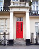 London, vintage house entrance with red door. London Sussex gardens area, vintage house entrance with red door and classical columns Royalty Free Stock Photography
