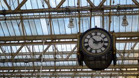London Waterloo station clock. On its own at five to three Royalty Free Stock Photos