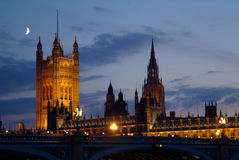 London - Westminster. Night view of Westminster with moon in the skies. View from Thames river Stock Photo
