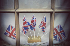 London window decorated with Union Jacks Stock Photo