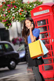 London woman talking smartphone shopping Royalty Free Stock Images