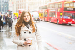 London, young business woman walking along the road Royalty Free Stock Photo