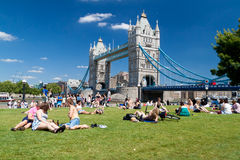 Londoners enjoying summer near Tower Bridge Royalty Free Stock Photography