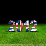 Londons olympic. British flag and 2012 text (olympic) on grass Stock Photos