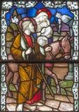 Londra - il volo della famiglia santa nell'Egitto sul vetro macchiato in st James Spanish Place della chiesa immagini stock