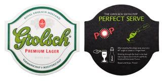 LONDRA, REGNO UNITO - 4 FEBBRAIO 2018: Sottobicchiere originale premio del beermat della birra chiara di Grolsch isolato su bianc fotografia stock libera da diritti