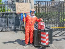 London / UK - June 26th 2019 - Pro-EU anti-Brexit protester dressed as a clown and holding `Build a bus with Boris` sign