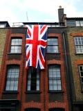 Londyn: East End Gruzinu tarasu dom z flaga Zdjęcie Stock