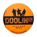 LONDYN, UK - LUTY 04, 2018: Dooliner beermat irlandzki czerwony piwny kabotażowiec odizolowywający na bielu Fotografia Stock