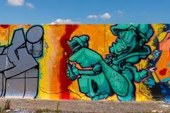 LONDYN, UK - MAJ 21, 2019 uliczna sztuka obrazów panorama na ścianie w parku w Londyn, ściana dokąd uliczni artyści mogą przedsta ilustracja wektor