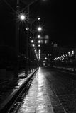 Lone. A Gotham-like lonely street at night Stock Images