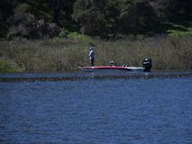 A lone angler fishes at Cachuma Lake in Santa Barbara County. Thanks to the rainy season in California, Lake Cachuma is experiencing water levels higher than it royalty free stock image