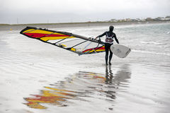 Lone Atlantic windsurfer getting ready to surf Stock Photography