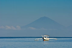 Lone Balinese Boat Against Mt. Agung Royalty Free Stock Images