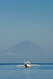 Lone Balinese Boat Against Mt. Agung Royalty Free Stock Photography
