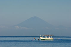 Lone Balinese Boat Against Mt. Agung Stock Image
