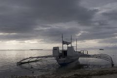 Lone Banca Fishing Boat at Sunset, Panglao Island, Bohol, Philippines Royalty Free Stock Image