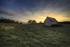 Lone barn. Sunset, South Wales Stock Photo