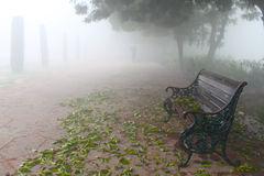 Lone bench over mist Royalty Free Stock Photography