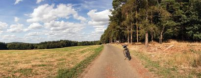 Panorama from lone bicycle parked on a rural road Royalty Free Stock Photos
