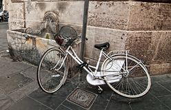 A lone bicycle thrown on the street. Royalty Free Stock Photography