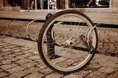 A lone bicycle wheel in a street Royalty Free Stock Photography