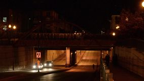 Lone biker riding at night stock footage