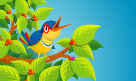 Lone bird singing on the branch of a tree on blue background Stock Photo