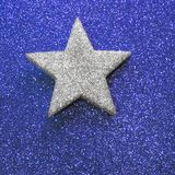Lone blazing silver star on golden shiny  background bright Stock Photos
