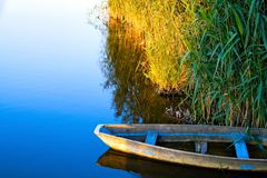 Lone boat. On calm water stock images