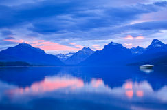 Lone Boat And Sunrise Colors On Calm Mountain Lake Stock Images