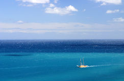 Lone boat blue sea Royalty Free Stock Photo