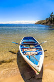 Lone boat, blue water and coast of Titicaca, Island of the Sun, Stock Photos