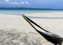 Lonely boat on the beach. Boat cut from a single tree trunk Royalty Free Stock Photos