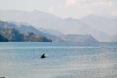 Lone Boat on a Lake in Nepal Stock Photo
