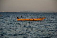A lone boat in the light of the setting sun in the port of Pattaya stock photos